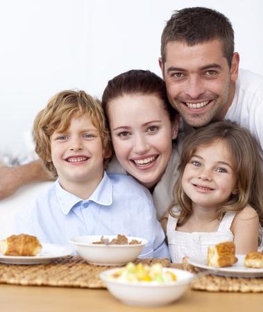 Portrait of happy family having breakfast photo