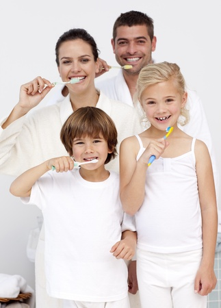 Cute caucasian Family brushing their teeth  photo