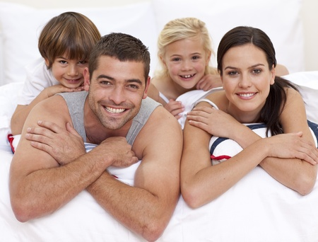 Happy family playing in parent Stock Photo - 10134646