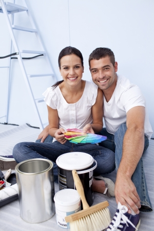 Couple with colour samples to paint new appartment photo