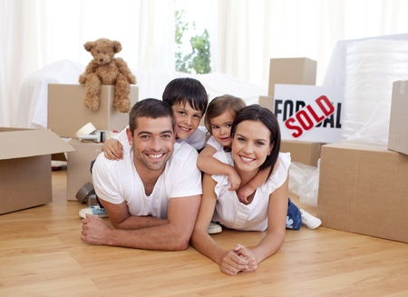 cardboard house: Happy family after buying new house