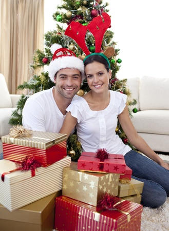 Happy couple celebrating Christmas at home photo