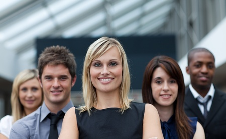 Beautiful businesswoman leading her team Stock Photo - 10134701