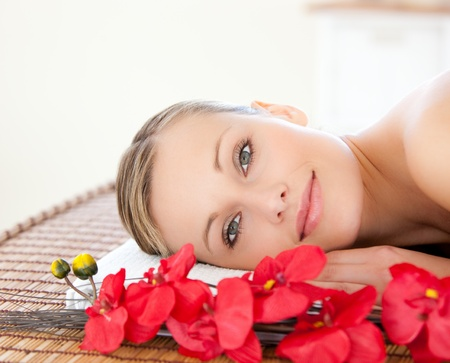 beauty treatment clinic: Radiant woman relaxing in a Spa center