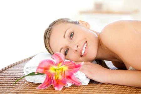 Portrait of a beautiful woman having a massage  photo