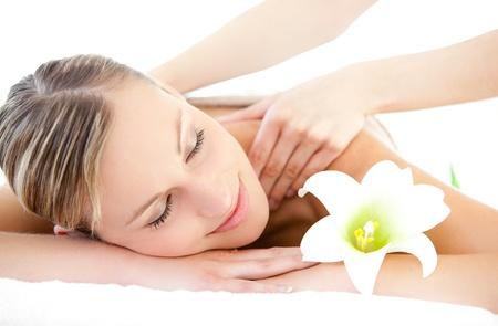 woman massage: Relaxed woman receiving a back massage