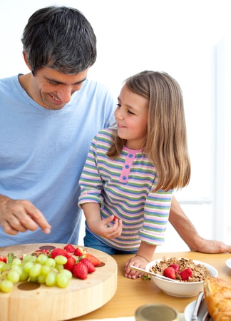 Happy father and his daughter having breakfast Stock Photo - 10134399