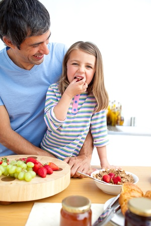 Jolly father and his daughter having breakfast  Stock Photo - 10133506