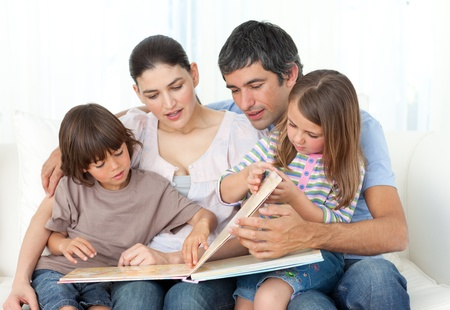 Attentive parents reading with their children  photo