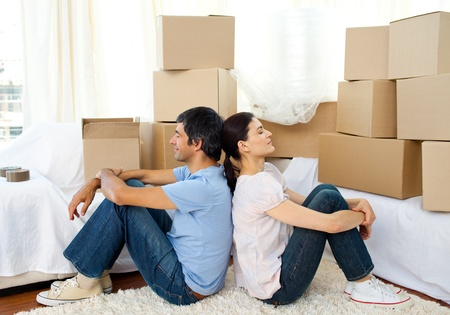 Tired couple relaxing while moving house photo