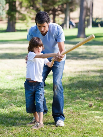catches: Positive father teaching baseball to his son Stock Photo