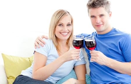 Cute couple drinking wine together in the living-room at home Stock Photo - 10131906