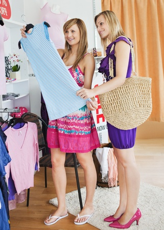 choosing clothes: United women choosing clothes together