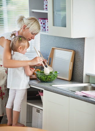 Concentrated mother and child cooking Stock Photo - 10133912