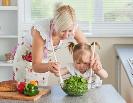 Blond mother and child cooking photo
