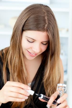 Charming girl using lipstick Stock Photo - 10134708