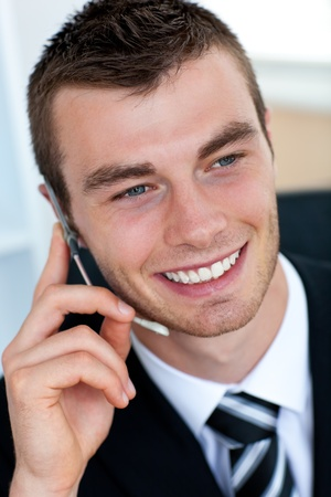 Pretty businessman using his mobile phone photo