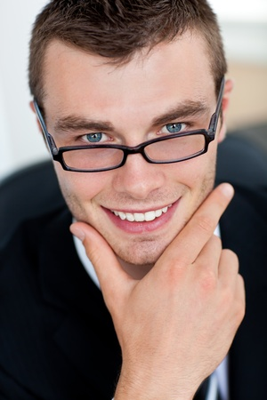 Smiling businessman with glasses photo