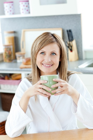 Smiling woman drinking something Stock Photo - 10134429