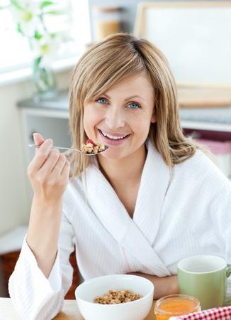 treating: Cute woman having breakfast Stock Photo