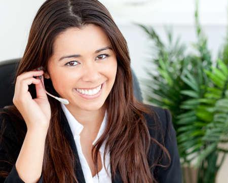 Confident asian businesswoman wearing headphones  photo