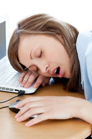 Tired young woman sleeping in her office Stock Photo - 10134406