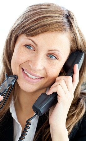 Attractive businesswoman talking on phone holding glasses Stock Photo - 10133855