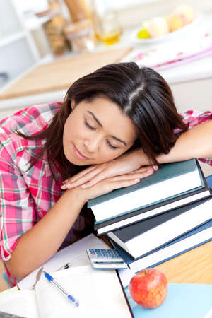 Tired asian student sleeping on her books  photo