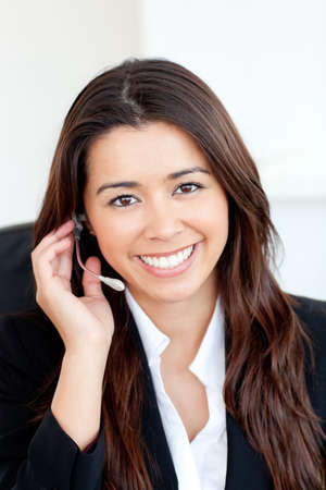 Confident asian businesswoman wearing headphones  photo