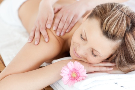 delighted: Delighted young woman receiving a back massage Stock Photo