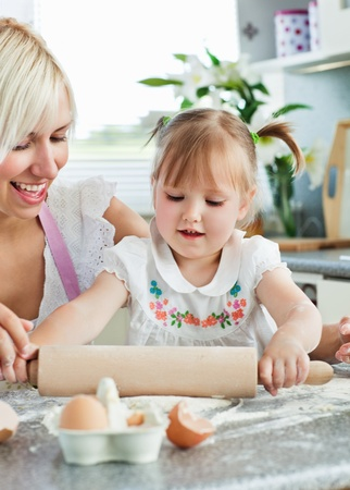 Lucky woman baking cookies with her daughter photo