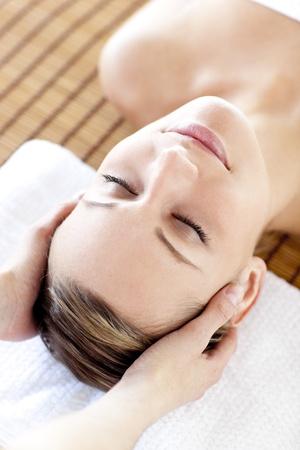 Caucasian relaxed woman having a head massage  photo