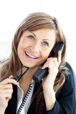 Confident young businesswoman talking on phone sitting Stock Photo - 10134720