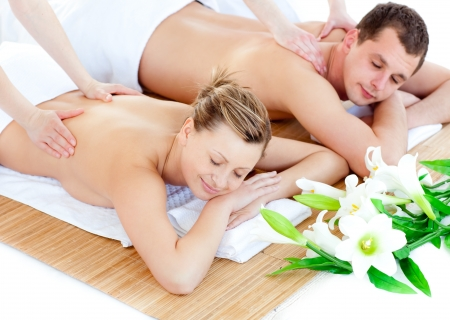couples therapy: Loving young couple enjoying a back massage Stock Photo