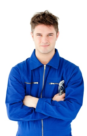 Charismatic mechanic holding tool smiling at the camera  Stock Photo - 10133521