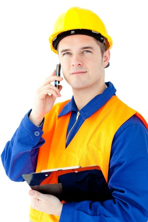 Charismatic worker talking on phone holding a clipboard photo