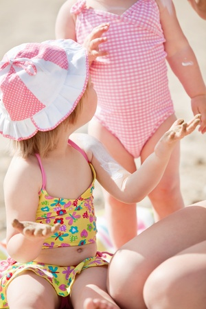Close-up of a cute little girl at the beach photo