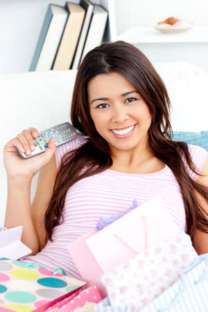 Attractive asian woman with shopping bags on the sofa at home photo