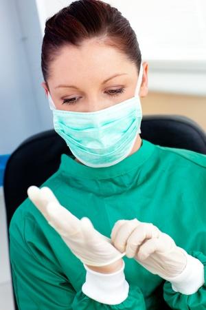 Serious female surgeon wearing scrubs  photo