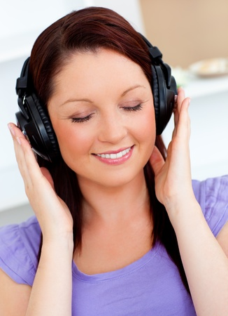 Blissful woman listen to music  photo