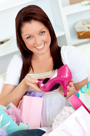 delighted: Delighted woman with shopping bags