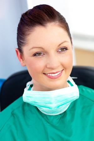 Portrait of a self-assured female surgeon wearing scrubs  photo
