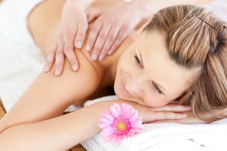 blissful: Blissful young woman enjoying a back massage