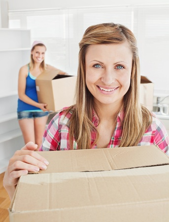 Delighted woman holding boxes after moving Stock Photo - 10133673