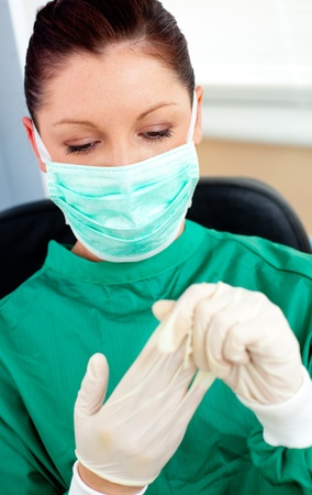 Beautiful female doctor with scrubs getting off her gloves Stock Photo - 10129963