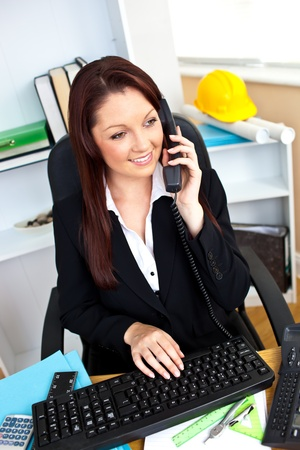 Portrait of a busy businesswoman talking on phone Stock Photo - 10131001
