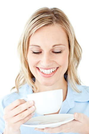 Glowing businesswoman holding a cup of coffee photo