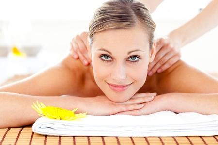 Portrait of a joyful woman lying on a massage table Stock Photo - 10131813