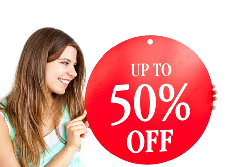 young add: Bright caucasian woman holding a up to 50% off red banner