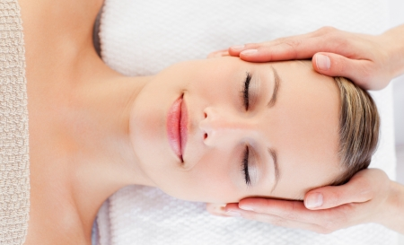 head rest: Young relaxed woman receiving a head massage